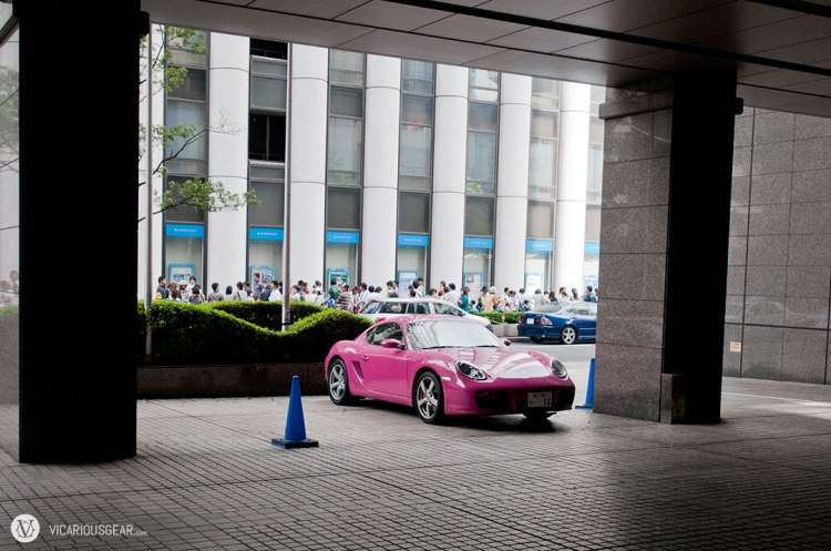 A pink Porsche Boxster stopping over at the Sheraton.