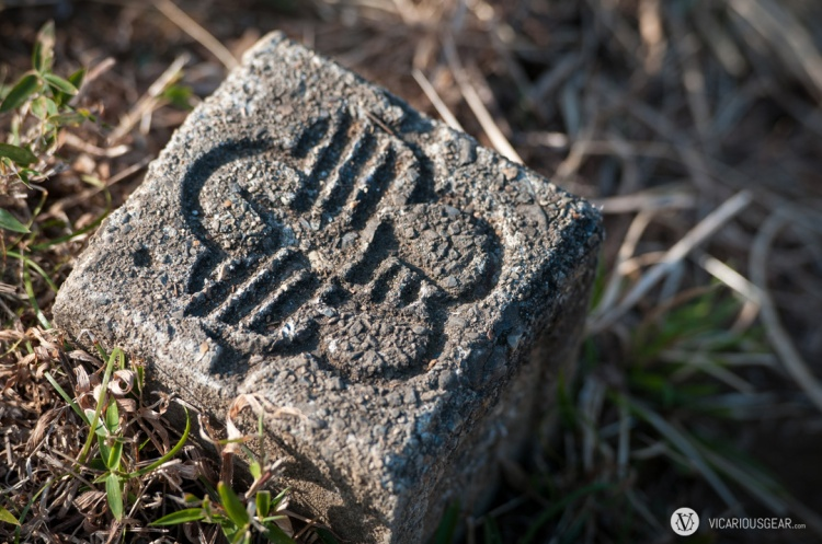 I only found one of these marking stones along the footpath in the park. I thought the stylized flower graphic on it was pretty neat.