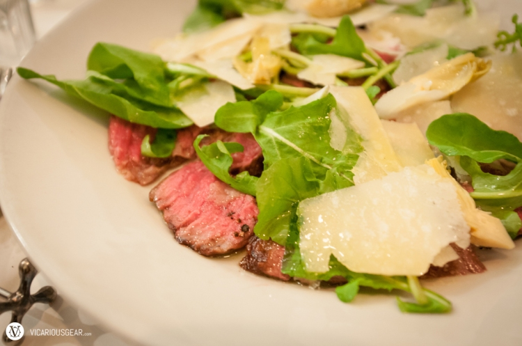 Chigasaki beef under a bed of arugula, heart of palm and parmesan