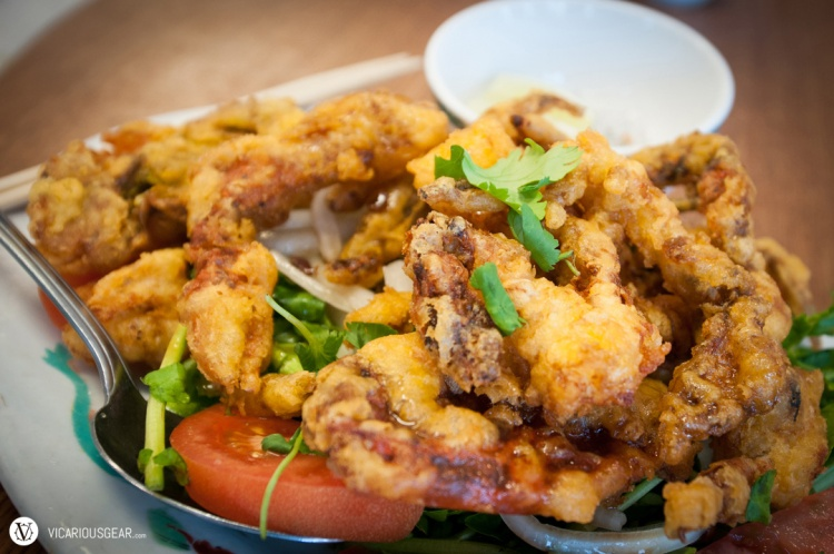 Butter fried soft-shell crab over a bed of lightly pickled watercress and tomato. Dip it in the muối tiêu chanh for a taste of crispy perfection.