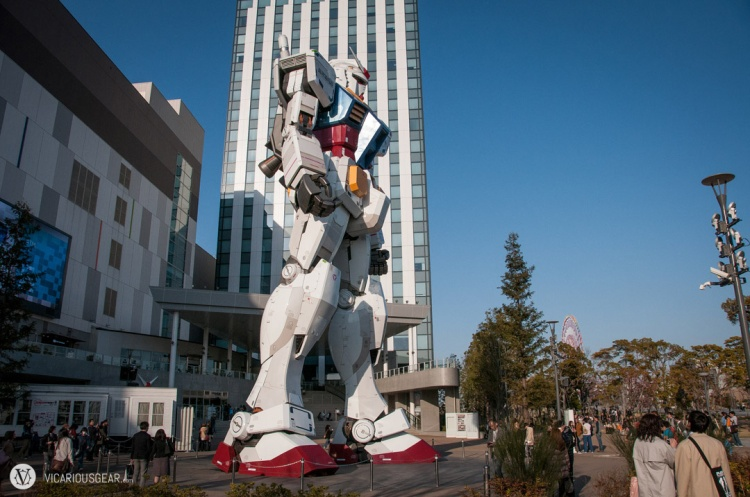 The first view of the huge Gundam as you turn the corner around the mall is from his right side.