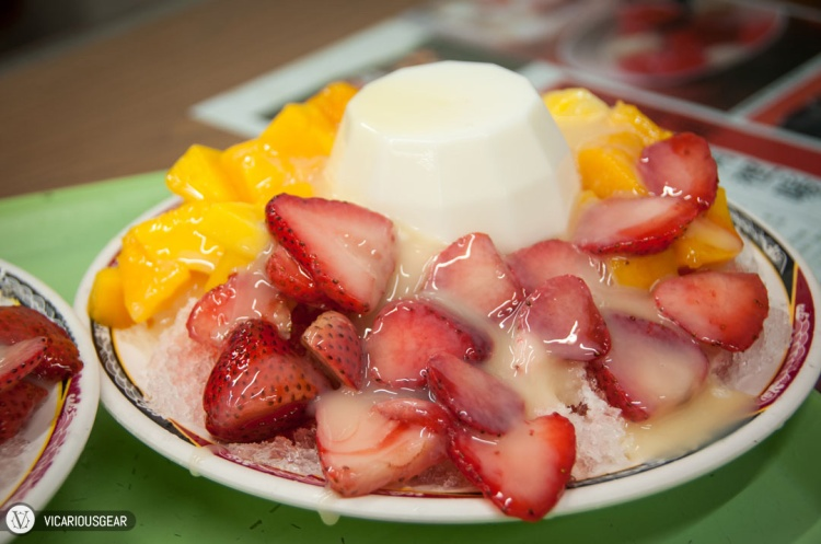 Mango, strawberry and milk pudding topped with condensed milk.