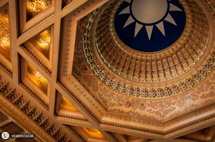 Above him was this very intricate ceiling with the symbol of the Order of Blue Sky and White Sun in the central dome.