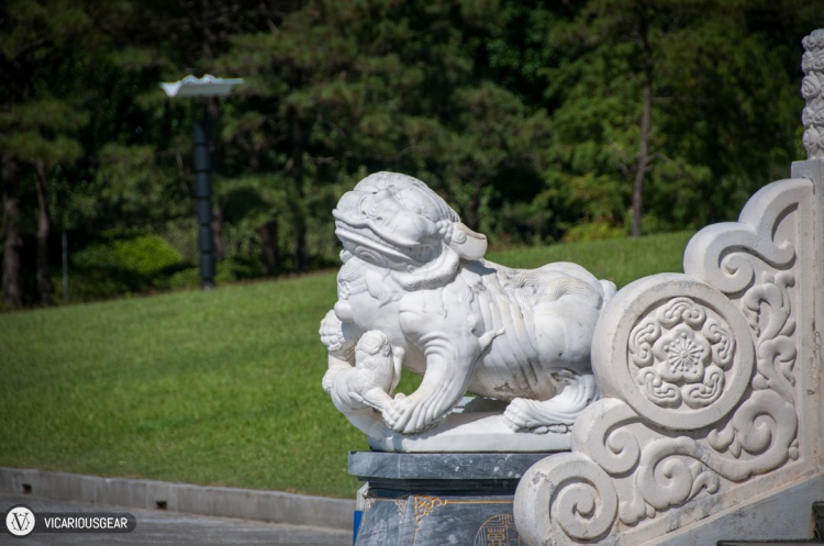 We made our way around and were greeted by traditional lion statues guarding each side of the staircase.