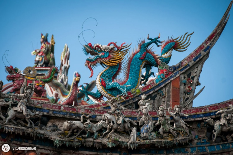 The roof is littered with intricate statues of deities and mystic creatures.