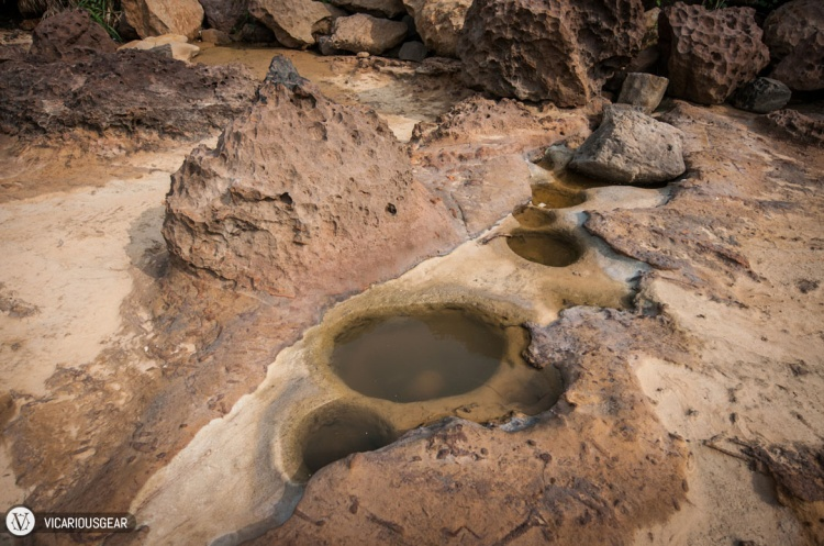 These pools of water had small boulders that broke off inside.