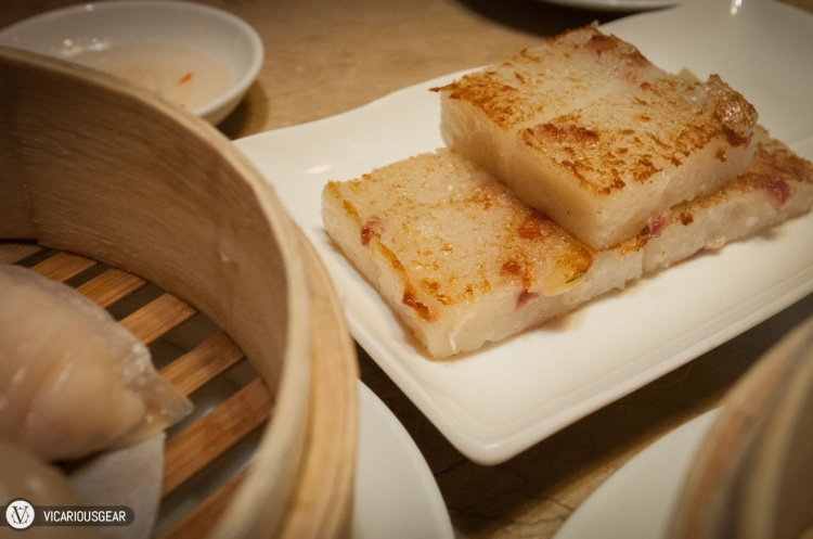 Fried turnip cake (Lo baak gou / 蘿蔔糕). Lightly pan fried without being burnt to a crisp.