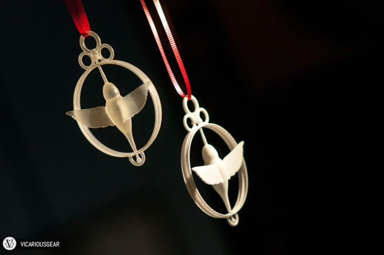 I decided to dust off my CAD skills and create a moving hummingbird pendant as the gift. Since it was my initial test and I was short on time, I had it printed in two different materials.