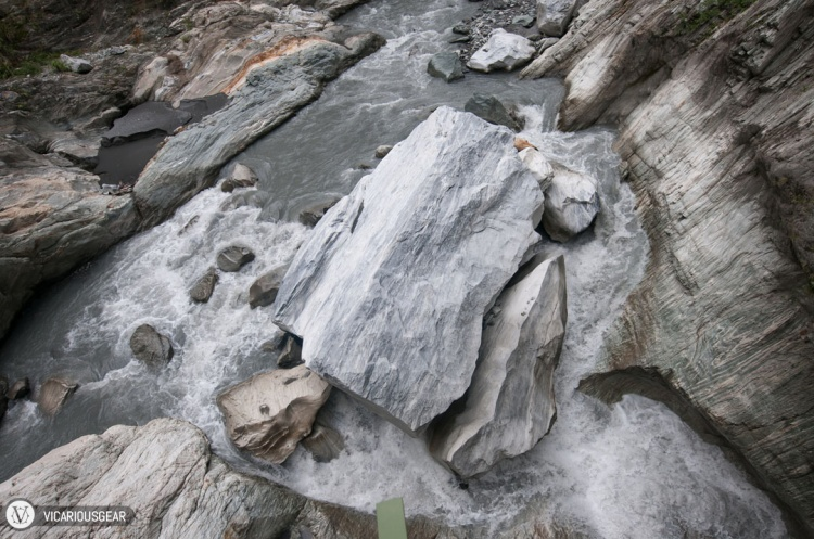 Giant boulder split by the rushing water.
