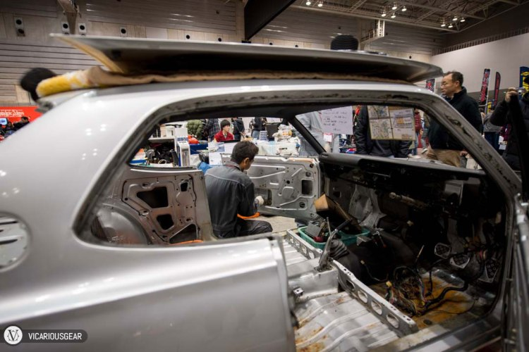 Next to the Datsun 16 was another shop reassembling a 2000GT in the middle of the show.