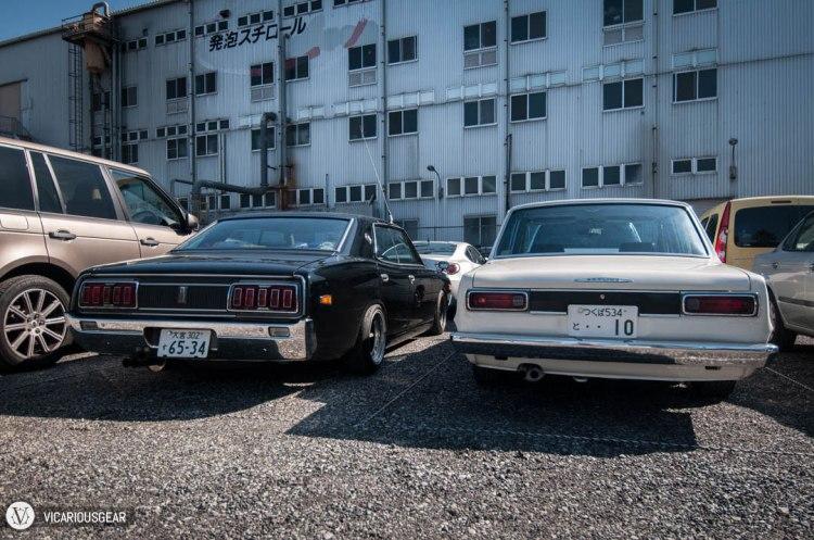 Good vs Evil. Nissan 230 Cedric and 2000GT Skyline sedans.