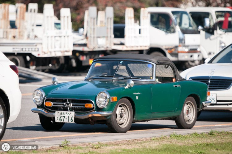 This Honda S800 chose to park amidst the largest cars and trucks it could find.